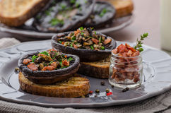 Portobello stuffed with herbs Stock Images