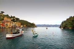 Portofino bay. Colorful buildings on the promenade of Portofino Stock Photos