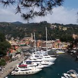 Portofino Harbour, marina, waterway, harbor, sky. Portofino Harbour is marina, sky and boat. That marvel has waterway, city and tree and that beauty contains stock photography