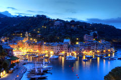 Portofino, Italy. Portofino is the most exclusive harbour and resort town in Italy. It is located on Ligurian coast near Genoa, at the tip of a peninsula bearing stock images