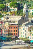 Portofino in Italy. Colorful buildings, San Martin church and tourists Royalty Free Stock Photos