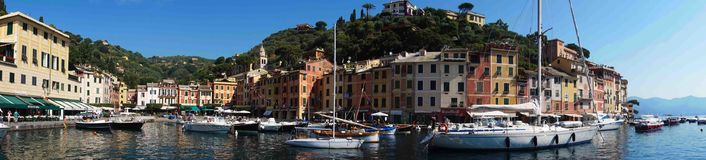PORTOFINO, ITALY - JUNE 13, 2017: amazing panoramic view of Portofino with colorful houses and villas, luxury yachts and boats. In little bay harbor. Liguria royalty free stock images