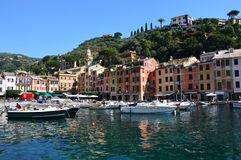 PORTOFINO, ITALY - JUNE 13, 2017: beautiful panorama of Portofino with colorful houses, luxury boats and yacht in little bay harbo Royalty Free Stock Photo