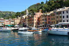 PORTOFINO, ITALY - JUNE 13, 2017: The beautiful Portofino panorama with colorful houses, luxury boats and yacht in little bay harb Royalty Free Stock Photos