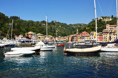 PORTOFINO, ITALY - JUNE 13, 2017: The beautiful Portofino panorama with colorful houses, luxury boats and yacht in little bay harb Royalty Free Stock Photography