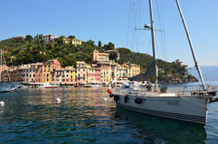 PORTOFINO, ITALY - JUNE 13, 2017: The beautiful Portofino panorama with colorful houses, luxury boats and yacht in little bay harb Royalty Free Stock Images