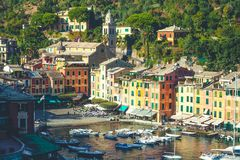 Portofino in Italy, sea and coast. Colorful buildings and tourists. Stock Photos