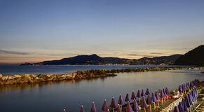 Portofino mount and Tigullio gulf at dusk, Chiavari, Italy Royalty Free Stock Photography