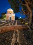 Portofino by night and Saint George church stock photos