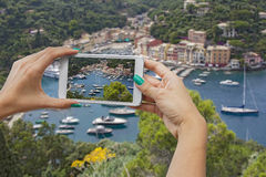 Portofino photographing with mobile phone. A woman photographing with mobile phone, Portofino, Cinque Terre, Italy Stock Photos