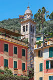 Portofino typical colorful houses and Divo Martino church bell tower Royalty Free Stock Image