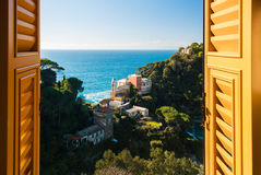 Portofino through a window. View of the hills around Portofino through a window Royalty Free Stock Photos