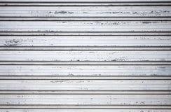 Portone grigio dell'otturatore del metallo, struttura del fondo Fotografie Stock