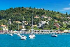 Portoroz town beach with boats Stock Photos