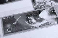 Portostämplar, utrymme fördärvar planeten Arkivfoto
