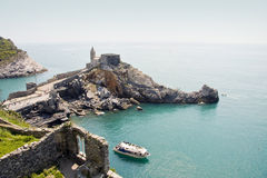 Portovenere. A view of the Portovenere village and the church of St. Peter's perched on the rocks stock image