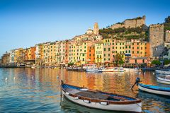 Portovenere at early morning sun. View of Portovenere, Italy. The early morning sun lights the colorful houses overlooking the sea.   Unesco World Heritage Royalty Free Stock Image