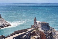 Portovenere view of the canall and Saint Peter's church Stock Images