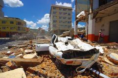 Portoviejo, Ecuador - April, 18, 2016: Collapsed car, showing the aftereffect of 7.8 earthquake that destroyed the city Royalty Free Stock Images