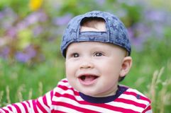 Portpait of happy baby boy in summer. Portpait of happy baby boy age of 10 months in summer Royalty Free Stock Photo