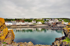 Portpatrick harbour framed by rocks Stock Photography