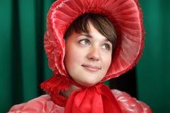 Porträt der Frau im Rot Stockfotos
