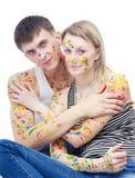 Porträt der Frau und des Mannes bedeckt mit Farben stockbild