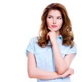 Porträt der jungen denkenden Frau Stockfotografie