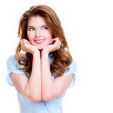 Porträt der jungen glücklichen durchdachten Frau Stockfotos