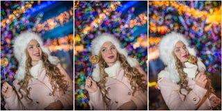 Porträt der jungen Schönheit mit dem langen angemessenen Haar im Freien am kalten Winterabend Schönes blondes Mädchen in der Wint Stockfotos