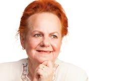 Porträt der lächelnden älteren Frau Stockfotos