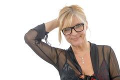 Porträt der lächelnden reifen Frau mit Brillen Stockfotos