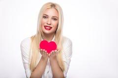 Porträt der schönen blonden Frau mit hellem Lizenzfreies Stockbild