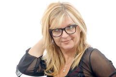 Porträt der schönen reifen Frau mit Brillen Stockbilder