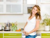 Porträt der schönen schwangeren Frau Lizenzfreies Stockbild