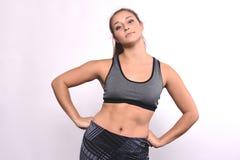Porträt der schöner und des Athleten jungen Frau Lizenzfreies Stockbild