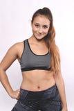 Porträt der schöner und des Athleten jungen Frau Lizenzfreies Stockfoto