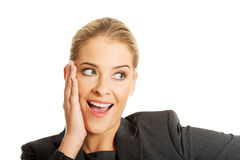 Porträt des überraschten rührenden Kinns der Geschäftsfrau Stockfoto