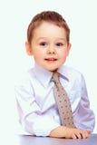 Porträt des überzeugten Geschäftskindes. drei Jahre alte Junge Stockfotografie