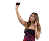Porträt des attraktiven und heißen Mädchens in den kurzen festen Kleidern, die selfie auf Smartphonekamera, lokalisierter weißer  Lizenzfreie Stockfotos