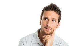 Porträt des durchdachten jungen Mannes Stockfotos