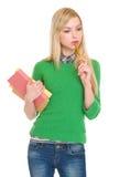 Porträt des durchdachten Studentenmädchens mit Büchern Lizenzfreie Stockfotos