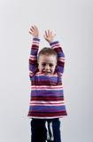 Porträt des emotionalen kleinen Jungen Stockfotografie