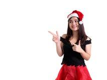 Porträt des enthusiastischen Weihnachtsmädchens, das etwas fördert Stockfoto