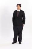 Porträt des fetten Geschäftsmannes im schwarzen Anzug Lizenzfreies Stockfoto
