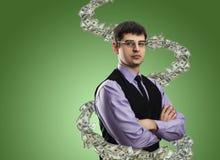 Porträt des Geschäftsmannes mit Geldturbulenz Lizenzfreie Stockfotografie