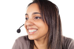Porträt des glücklichen lächelnden netten Stütztelefonbetreibers im Kopfhörer Lizenzfreies Stockbild