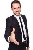 Porträt des lächelnden Angebothändedrucks des Geschäftsmannes Stockfotografie