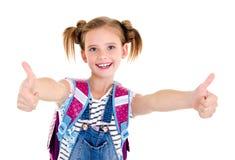 Porträt des lächelnden glücklichen Schulmädchenkindes mit Schultasche und Lizenzfreie Stockbilder