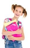 Porträt des lächelnden glücklichen Schulmädchenkindes mit Schultasche und Stockbild